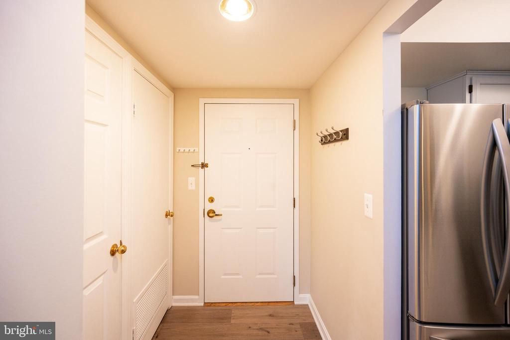 Front foyer with large coat closet - 2400 CLARENDON BLVD #301, ARLINGTON