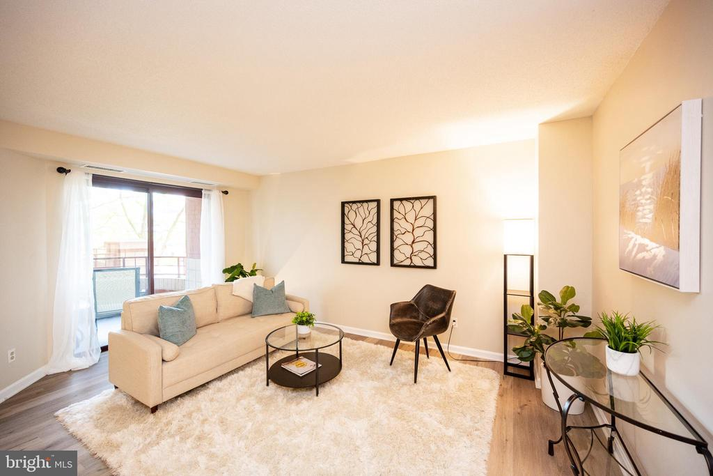 Living area with sliding doors to open air balcony - 2400 CLARENDON BLVD #301, ARLINGTON