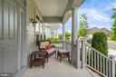 A ful front porch with sidewalks out front - 17037 SILVER ARROW DR, DUMFRIES