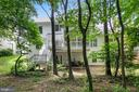 another view from the trees - 1114 HEARTFIELDS DR, SILVER SPRING