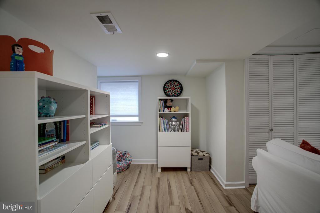 LL Basement great has modern faux wood floor - 8622 GARFIELD ST, BETHESDA