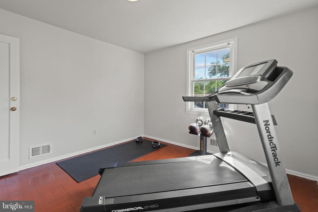 Main level bedroom 2 is currently a gym. - 2915 MONROE PL, FALLS CHURCH