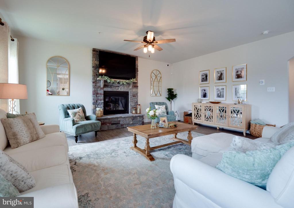 Family Room with Stone Fireplace - 6877 WOODRIDGE RD, NEW MARKET