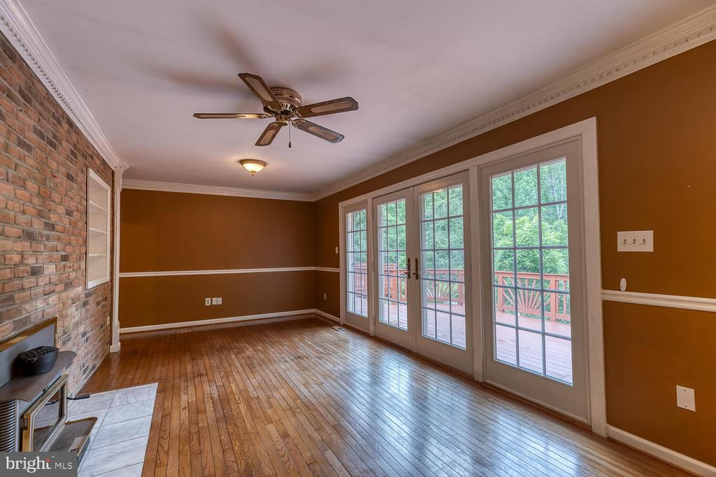 Living room with wood stove - 710 WIDEWATER RD, STAFFORD
