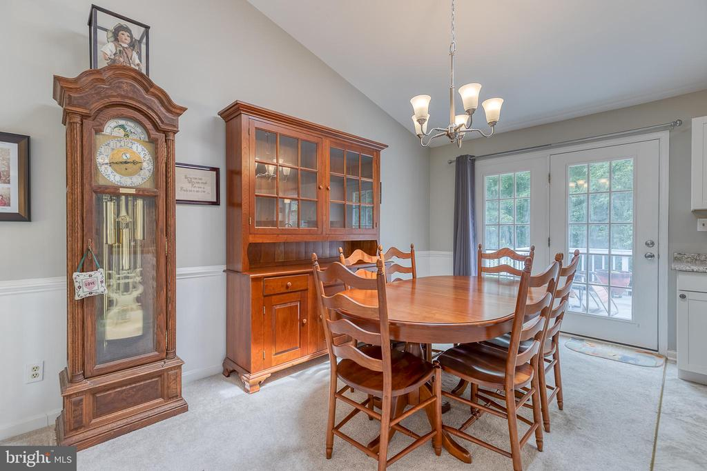 Dining room with access to outside deck. - 7420 LAURA LN, FREDERICKSBURG