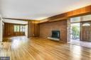 Living room with wood burning fireplace - 6801 GRANBY ST, BETHESDA