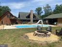 Fully Fenced Backyard with Fire Pit. - 23039 RAPIDAN FARMS DR, LIGNUM
