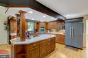 big kitchen with large island and tons of storage - 2415 BLACK CAP LN, RESTON