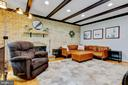 family room with exposed brick and beams - 2415 BLACK CAP LN, RESTON