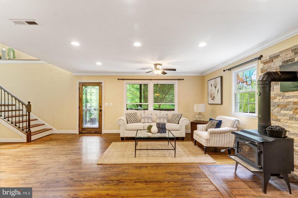 Large hard wood floored living room - 12805 KAHNS RD, MANASSAS