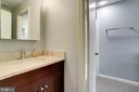 Half bath opens to tub shower area - 6705 WASHINGTON BLVD #G, ARLINGTON