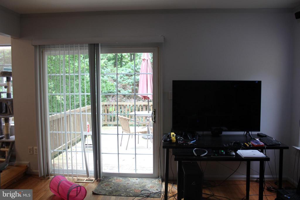 Family room leading to Deck1 - 8235 WALNUT RIDGE RD, FAIRFAX STATION