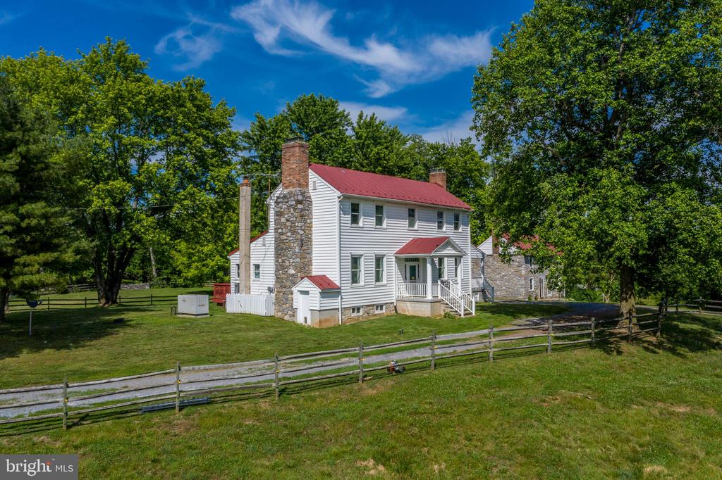 Main house faces south - 675 LIME MARL LN, BERRYVILLE
