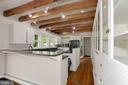 Kitchen with beamed ceilings - 675 LIME MARL LN, BERRYVILLE
