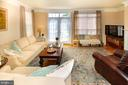 Gracious family room with access to deck - 5000 DONOVAN DR, ALEXANDRIA