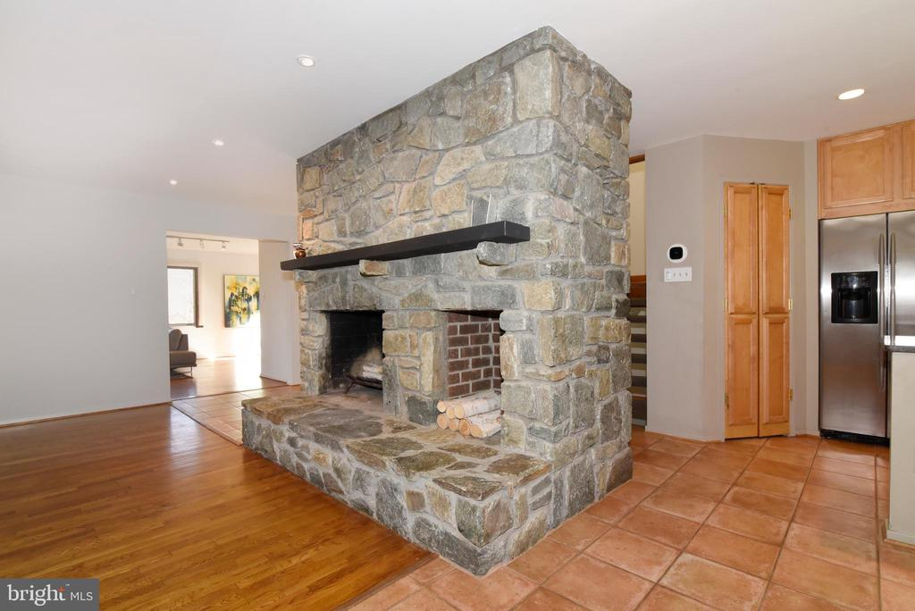 Family Room stone wood burning Fireplace - 1101 PEPPERTREE DR, GREAT FALLS