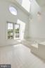Primary bathroom with new round window - 6151 BRAELEIGH LN, ALEXANDRIA