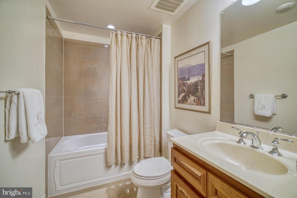 The hall bath also serves as the