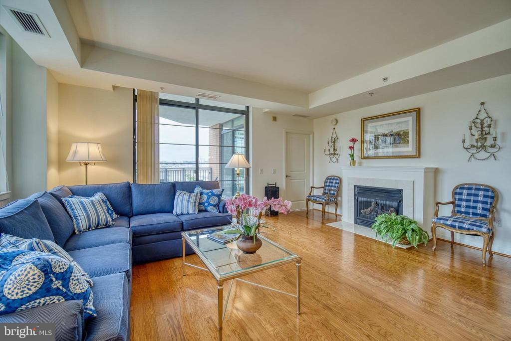 Balcony access from living room or primary bedroom - 1830 FOUNTAIN DR #604, RESTON