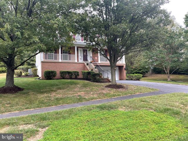 FRONT WITH DRIVEWAY - 15355 BALD EAGLE LN, WOODBRIDGE