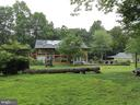 HOUSE HAS MANY GREEN AREAS FOR FUN - 12101 FOUNTAIN DR, CLARKSBURG