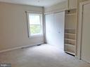 SECOND BEDROOM  built in shelving - SUNROOM ACCESS - 12101 FOUNTAIN DR, CLARKSBURG
