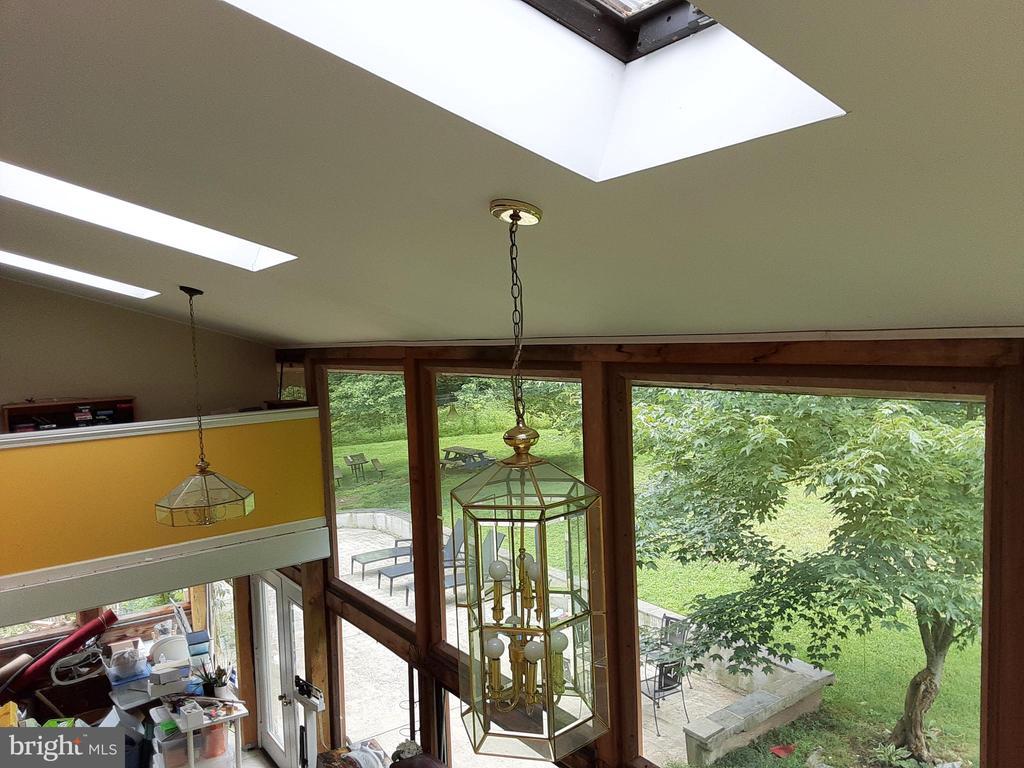 BEDROOM to BALCONY in the sunroom SKYLIGHTS GALORE - 12101 FOUNTAIN DR, CLARKSBURG