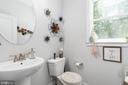 Main level half bath. - 10903 STOCKADE DR, SPOTSYLVANIA