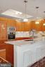 Kitchen - Tray Ceiling, Recess & Pendant Lighting! - 1881 N NASH ST #307, ARLINGTON