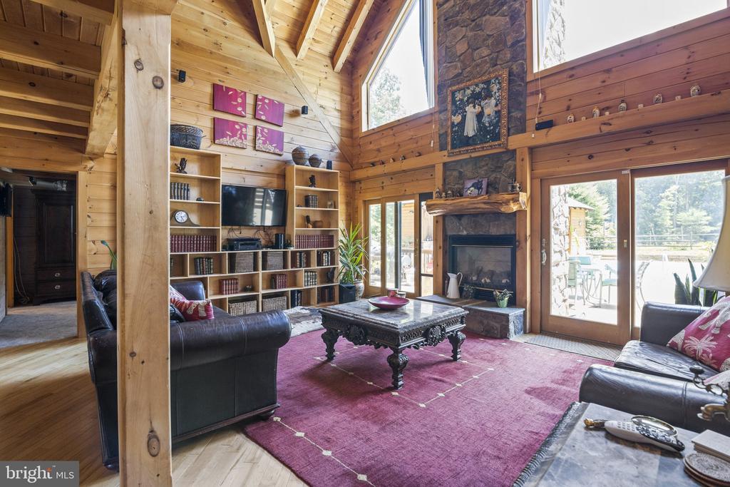 Floor To Ceiling Stone Hearth & Gas Log Fireplace. - 23039 RAPIDAN FARMS DR, LIGNUM
