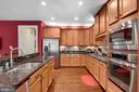 Gourmet kitchen, lots of cabinets/prep area. - 21260 PARK GROVE TER, ASHBURN