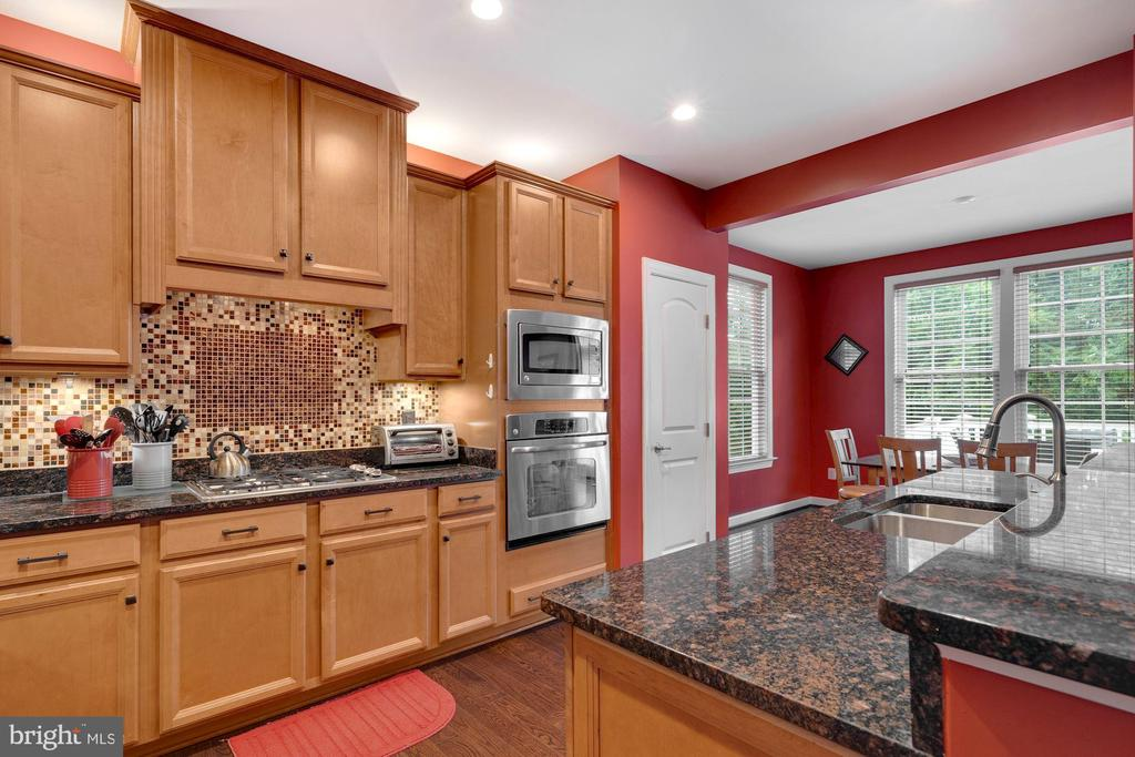Kitchen view of the cooktop. - 21260 PARK GROVE TER, ASHBURN