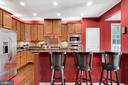 Kitchen view, bar area with seating. - 21260 PARK GROVE TER, ASHBURN