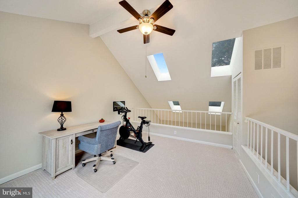skylights brighten the top floor loft for office - 4427 7TH ST N, ARLINGTON