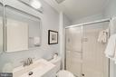 primary bath with vanity and cabinet storage - 4427 7TH ST N, ARLINGTON