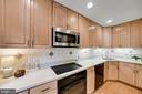 ample cabinets and generous countertops - 4427 7TH ST N, ARLINGTON
