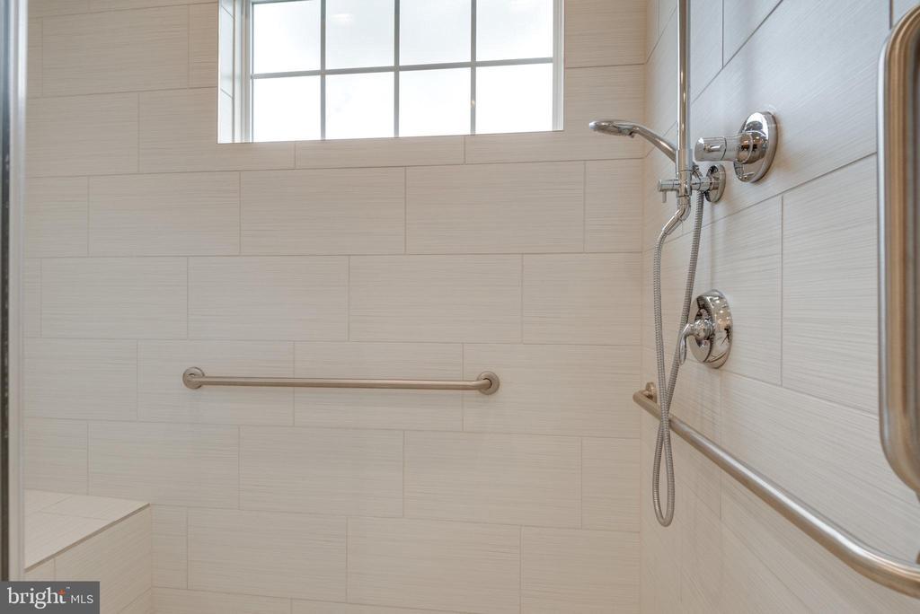 Sleek upgraded tile in primary bath. - 42758 AUTUMN DAY TERRACE, ASHBURN