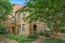 well sited in a courtyard surrounded by greenery - 4427 7TH ST N, ARLINGTON