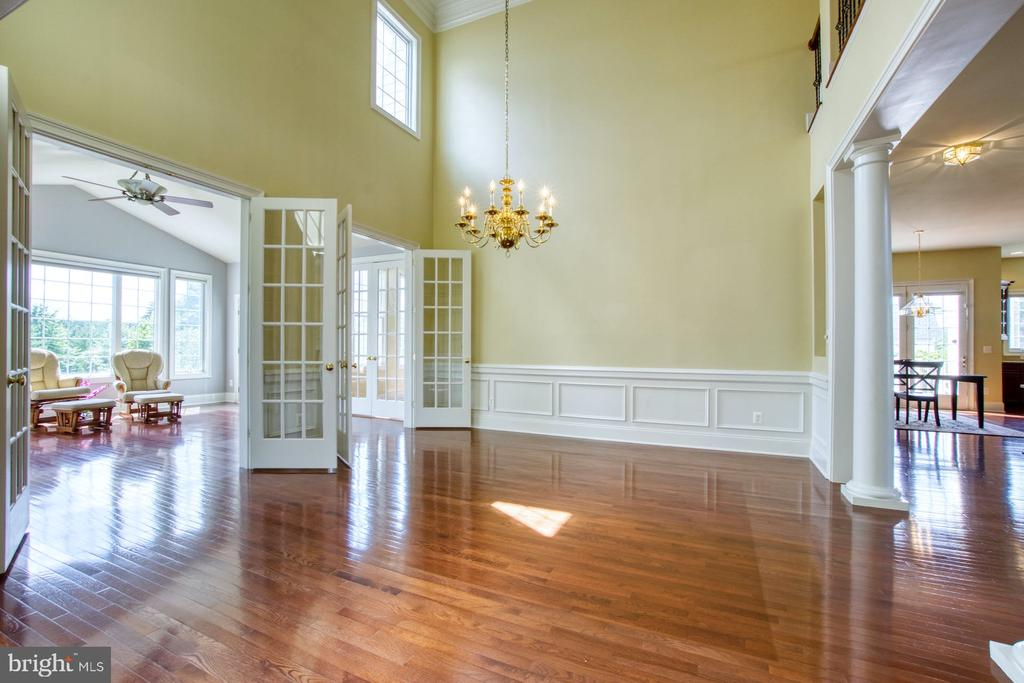 FORMAL DINING ROOM LEADS INTO THE SUNROOM - 20003 BELMONT STATION DR, ASHBURN