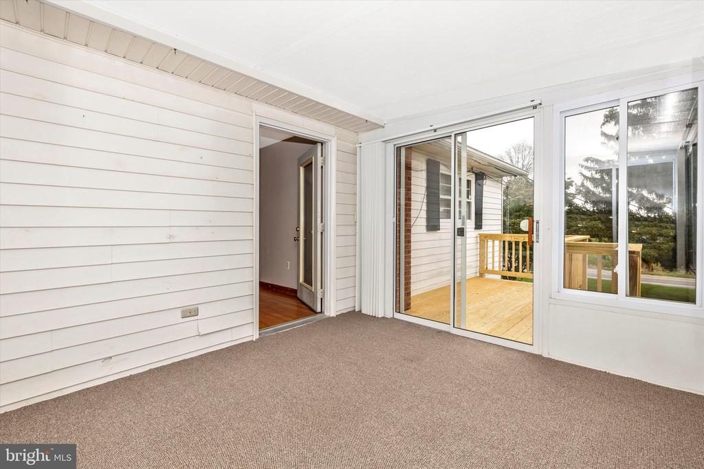Sunroom and private deck off primary bedroom - 9822 HANSONVILLE RD, FREDERICK