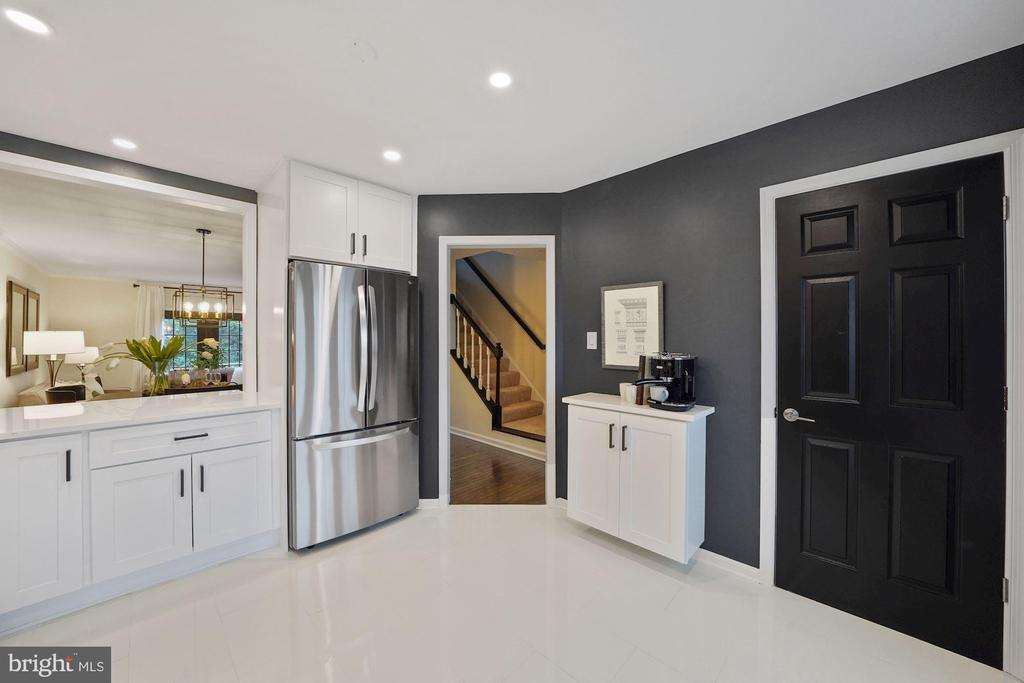 You can see a door to the laundry room on right - 4110 WASHINGTON BLVD, ARLINGTON