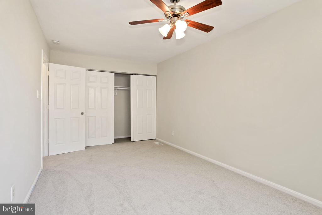 The primary bedroom with closet. - 9761 HAGEL CIR #E, LORTON