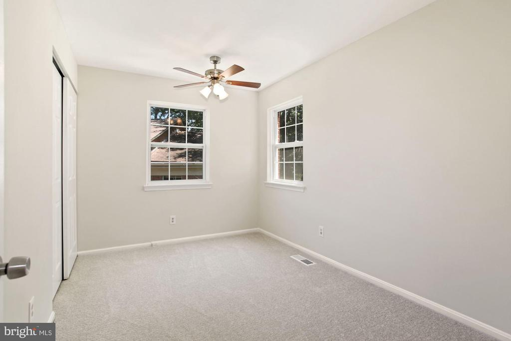 The primary bedroom - note ceiling fan. - 9761 HAGEL CIR #E, LORTON