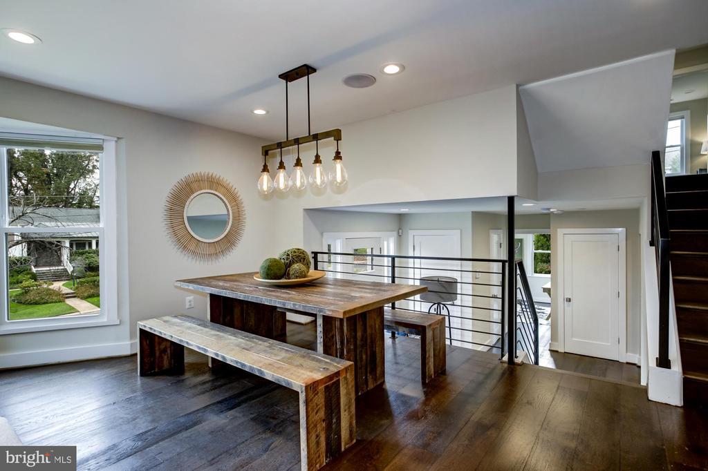 Dining room has modern lighting - 5507 DURBIN RD, BETHESDA