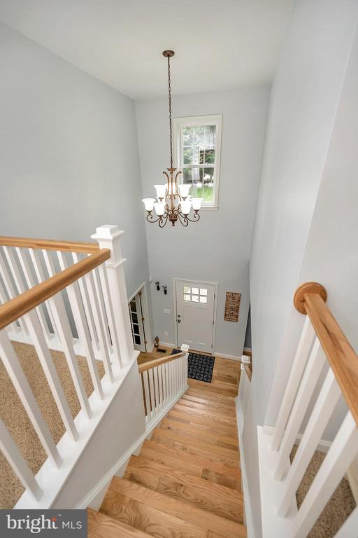 Staircase to upper level - 7398 JACKSON DR, KING GEORGE