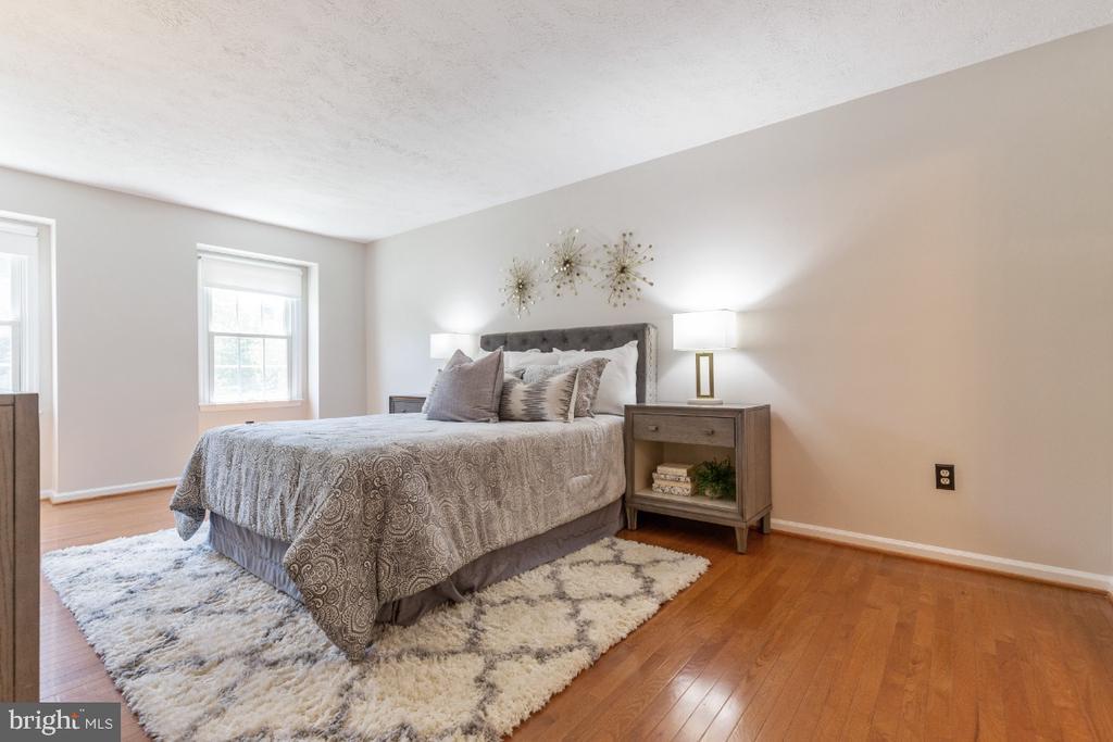 Primary bedroom with hardwood floors - 7324 JENNA RD, SPRINGFIELD