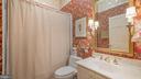 hall bath with tub shower - 100 E 2ND ST, FREDERICK