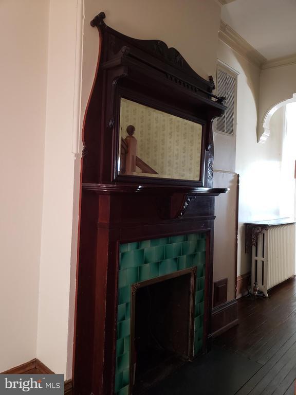 Fireplace in Main Hall of 1115 Rhode Island Ave NW - 1115 RHODE ISLAND AVE NW, WASHINGTON