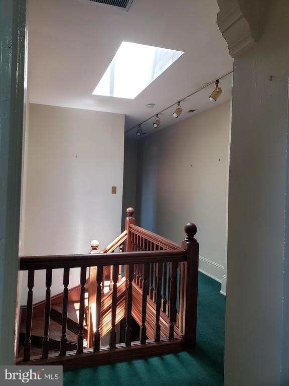 Stairwell up to 3rd Floor, Skylight. - 1115 RHODE ISLAND AVE NW, WASHINGTON