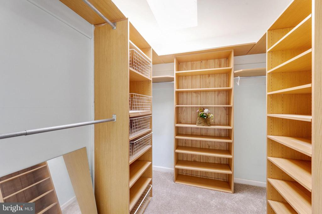 Walk in closet with shelving & a skylight - 3208 SHOREVIEW RD, TRIANGLE